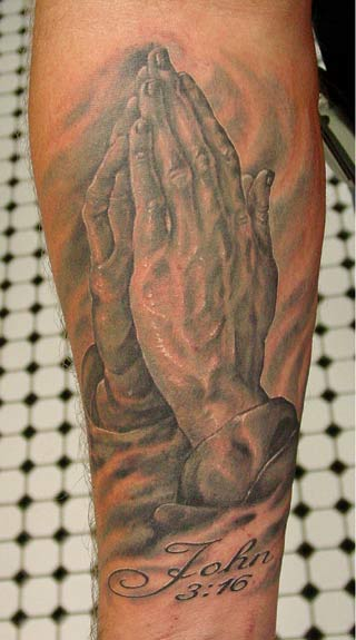 praying hands tattoo. Praying hands
