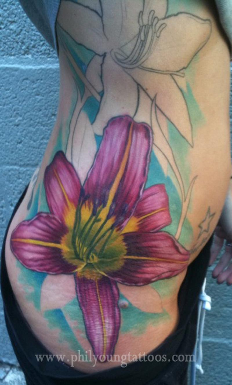 Lily tattoo on ribs in