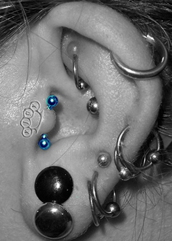 Vertical Tragus Body Piercing