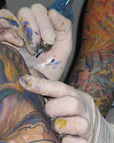 Guy Tattooing