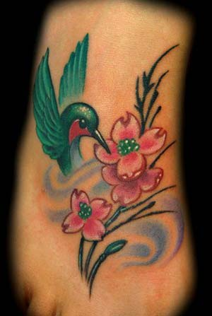 See more on Small Flower Foot Tattoo and Smoke Spiral Tattoos.