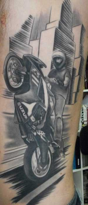 Muckho buzz tattoo pols for Motorcycle tattoo sleeve