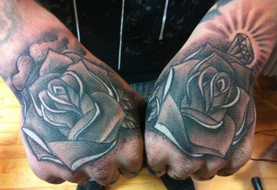 roses on hands tattoo