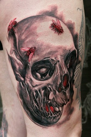 Tattoo of the day goes to Kynst for this skull tattoo .