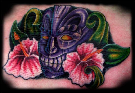 Tiki Tattoo. At the London Tattoo Convention tiki and flowers.