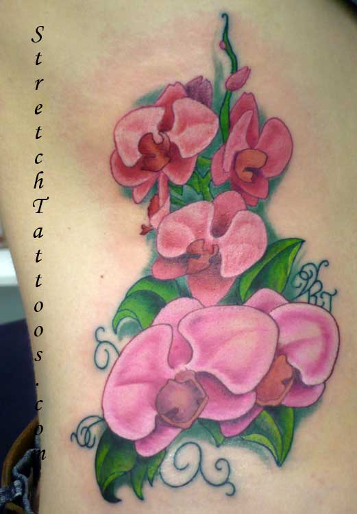 Flower Tattoos On Stomach. Tattoos with flowers represent